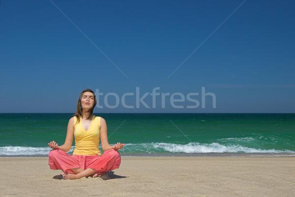 Woman making yoga in the bach Stock photo © iko