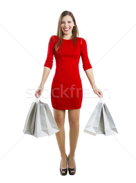 Nő bevásárlótáskák gyönyörű vonzó nő mosoly nők Stock fotó © iko