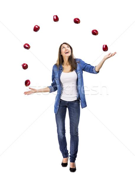 Woman throwing apples Stock photo © iko
