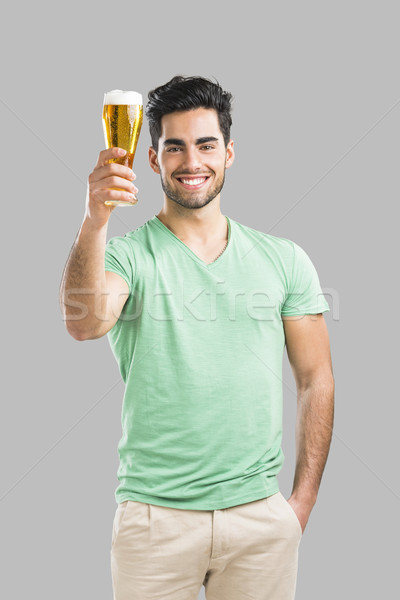 Young man drinking beer Stock photo © iko