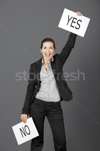 Oui choix affaires jeune femme gris Photo stock © iko