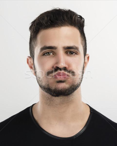Vervelen man studio portret knap jonge man Stockfoto © iko