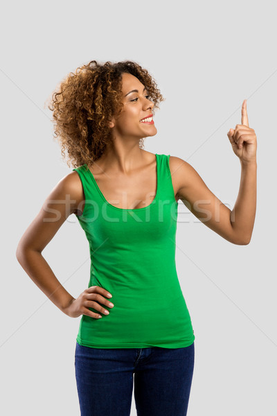 Woman with a finger on the air Stock photo © iko