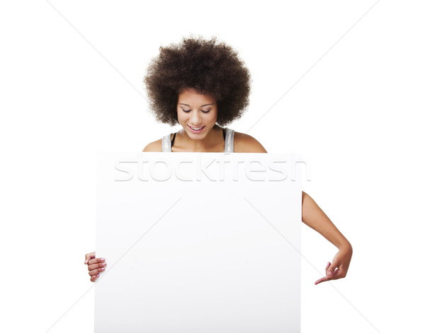 Woman holding a white billboard Stock photo © iko