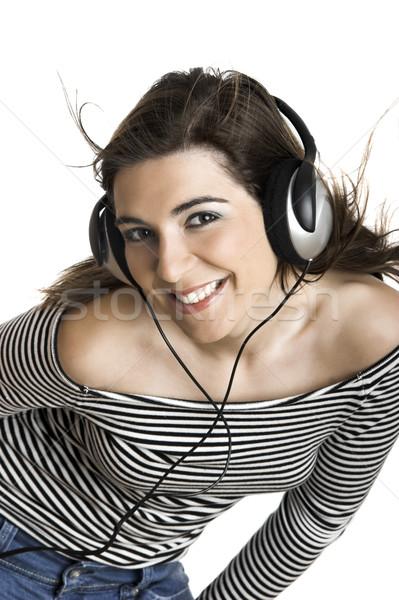 Escuta música belo mulher jovem fones de ouvido isolado Foto stock © iko