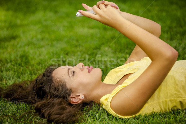 Gülen genç kadın çim Stok fotoğraf © iko