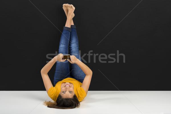 Happy girl texting Stock photo © iko