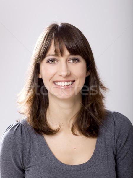 純正 笑顔 美しい 若い女性 笑みを浮かべて グレー ストックフォト © iko