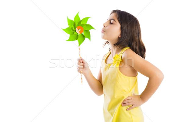 Girl blowing a windmill Stock photo © iko