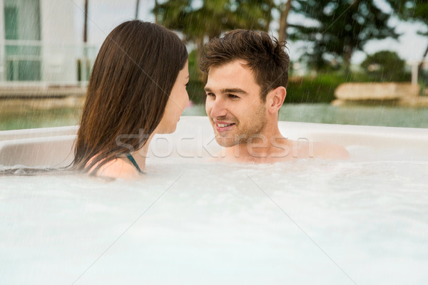 Stock photo: Young couple in a jacuzzi