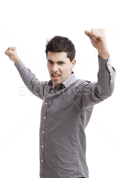 Happy young man with arms up isolated on a white background  Stock photo © iko