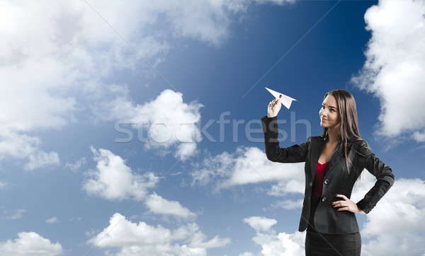 Business woman throwing a paper plane Stock photo © iko