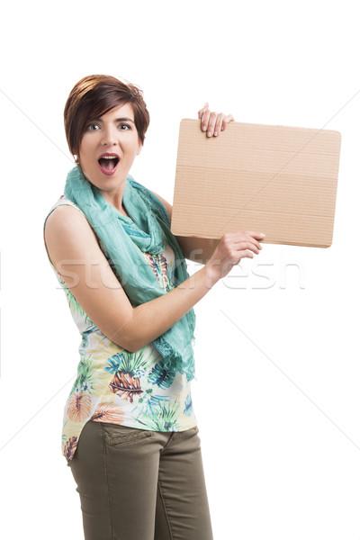 Beautiful woman with a cardboard Stock photo © iko