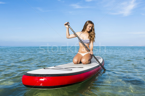 Stock photo: Woman practicing paddle