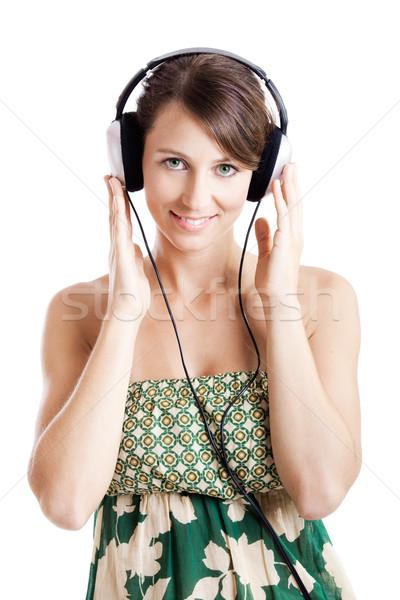 聞く 音楽 美しい 若い女性 ヘッドホン 孤立した ストックフォト © iko