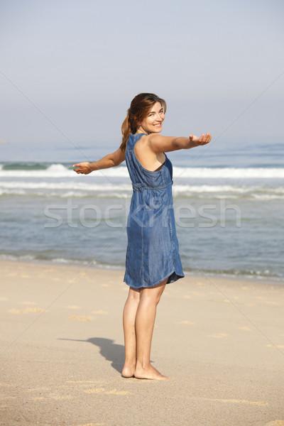 Сток-фото: наслаждаться · пляж · красивой · расслабляющая · оружия