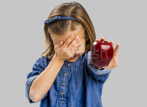 Cute girl holding an apple Stock photo © iko