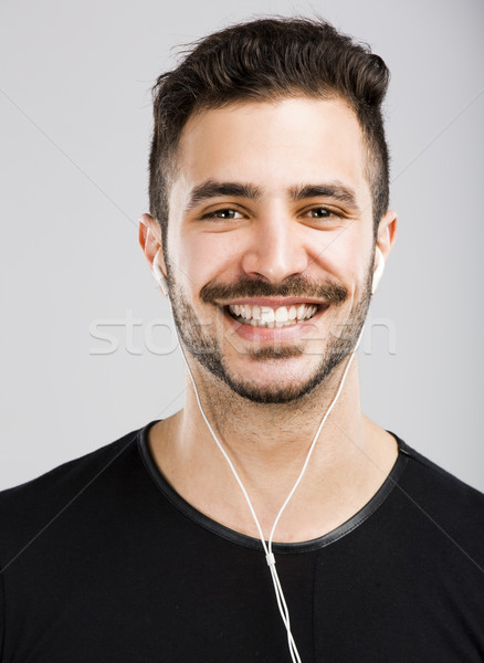 Man smiling and listen music Stock photo © iko
