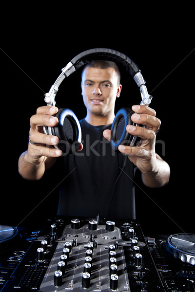 Portrait of a DJ playing disco electro music in a concert Stock photo © iko