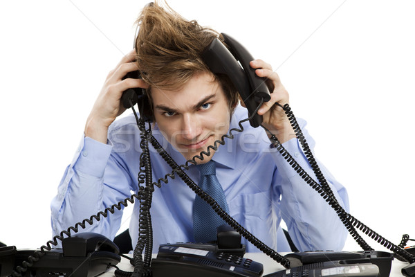 Wielokrotność czasu młody człowiek posiedzenia biuro kilka Zdjęcia stock © iko