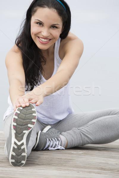 Woman doing exercises Stock photo © iko