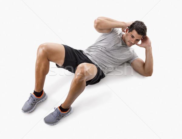 Man doing abdominals Stock photo © iko
