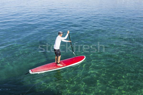 Senior man practicing paddle Stock photo © iko