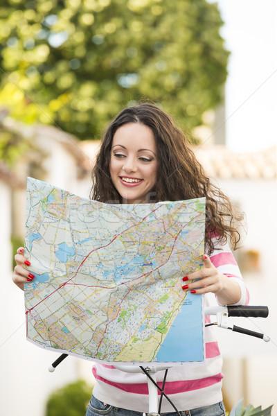 Beautiful tourist searching on the map Stock photo © iko