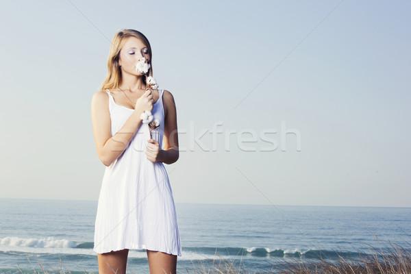 Smelling a cotton plant Stock photo © iko