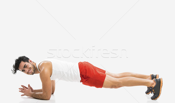 Athletic man doing push-up Stock photo © iko