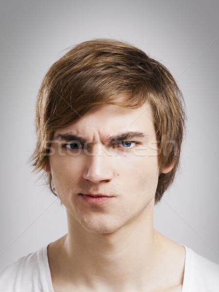 şüpheli yüz portre yakışıklı genç gri Stok fotoğraf © iko