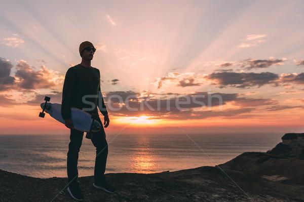 Skater boy at sunset Stock photo © iko