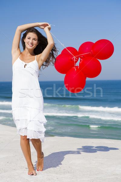 Güzel kız kırmızı kadın plaj gökyüzü Stok fotoğraf © iko