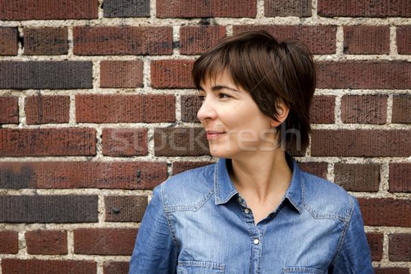 Spokojny kobieta murem kobiet szczęśliwy Zdjęcia stock © iko