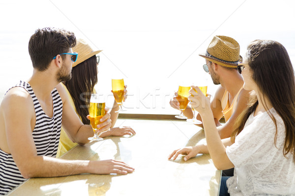 Friends drinking a cold beer Stock photo © iko