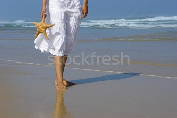 Starfish mulher bela mulher praia mão água Foto stock © iko
