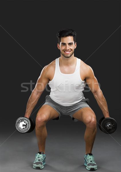 Adam ağırlıklar portre yakışıklı Stok fotoğraf © iko