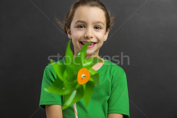 Petite fille moulin à vent belle sourire enfants Photo stock © iko