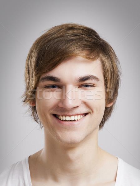 Vidám arc portré jóképű fiatalember szürke mosoly Stock fotó © iko