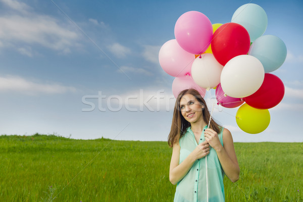 Kız genç güzel bir kadın renkli balonlar yeşil Stok fotoğraf © iko