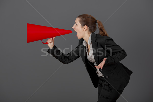 Woman with a megaphone Stock photo © iko