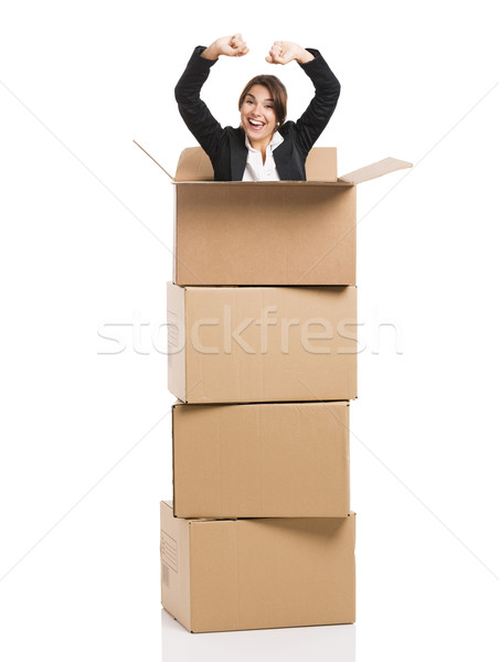 Business woman appear inside card boxes Stock photo © iko