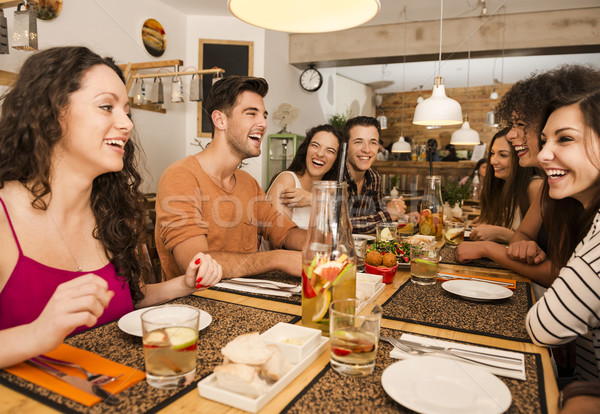 Friends lunching at the restaurant Stock photo © iko