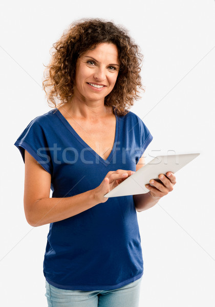 Happy woman working with a tablet Stock photo © iko