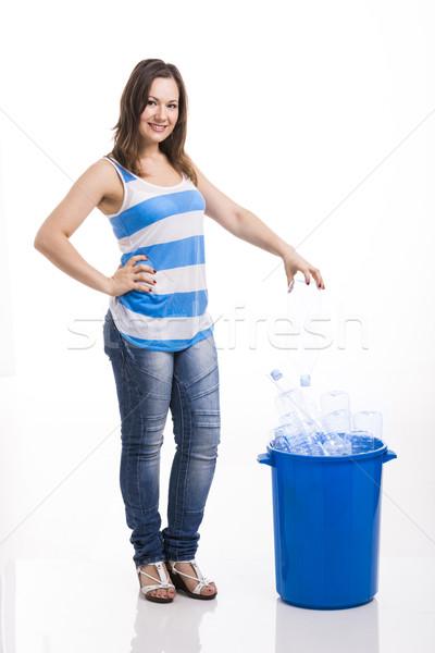Beautiful young woman recycling Stock photo © iko