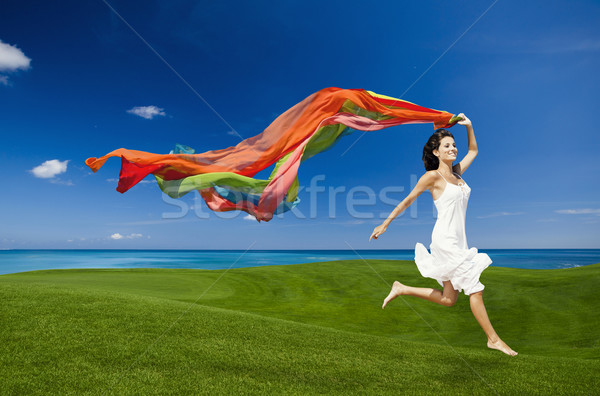 jumping with colored tissues Stock photo © iko