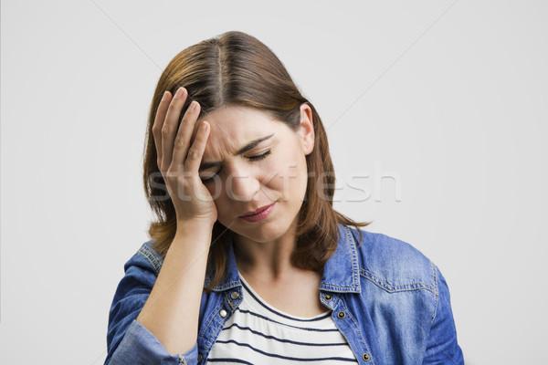 Sentimento terribile mal di testa frustrato donna Foto d'archivio © iko