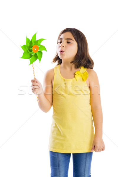 Stock photo: Girl blowing a windmill