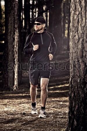Lasu człowiek wykonywania uruchomiony ciało Zdjęcia stock © iko