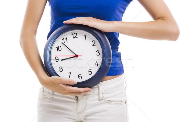 Beautiful woman with a clock Stock photo © iko